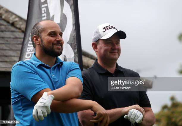 Giuseppe Licata of Chipping Sodbury Golf Club and Edward Goodwin of Cirencester Golf Club watch on the 1st tee during The Golfbreakscom PGA Fourball...