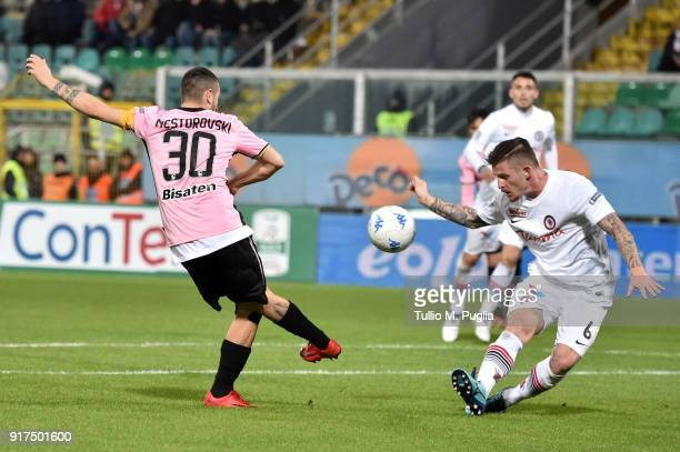 Giuseppe Loiacono of Foggia blocks a shot from Ilija Nestorovski using his hand which resulted in a penalty kick for Palermo during the Serie B match...
