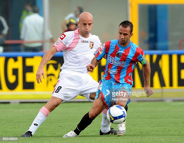 Giuseppe Mascara of Catania and Giulio Migliaccio of Palermo in action during the Serie A match between Catania and Palermo at the Stadio Cibali on...