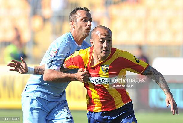 Giuseppe Mascara of Napoli and Javier Chevanton of Lecce in action during the Serie A match between Lecce and SSC Napoli at Stadio Via del Mare on...