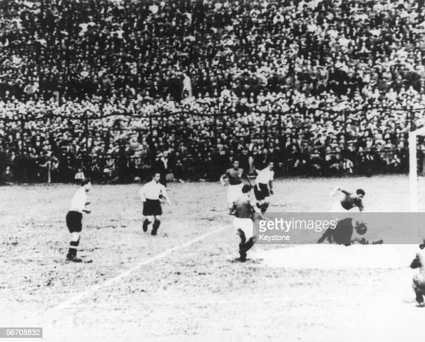 Giuseppe Meazza of Italy outplays an Austrian forward to set up Enrico Guaita to score ten minutes into his team's World Cup semifinal against...