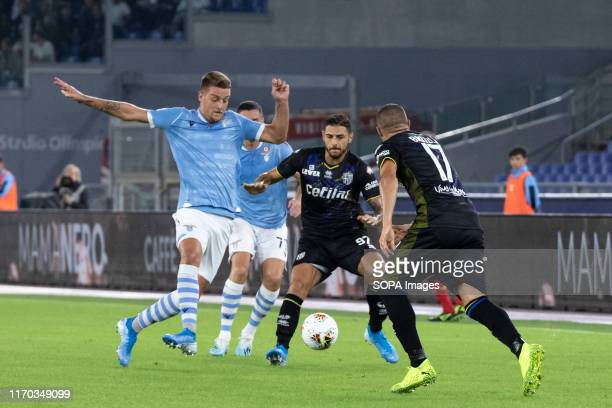 Giuseppe Peezzella of Parma and Sergej Milinkovic Savic of Lazio are seen in action during the Serie A match between Lazio and Parma at Olimpico...