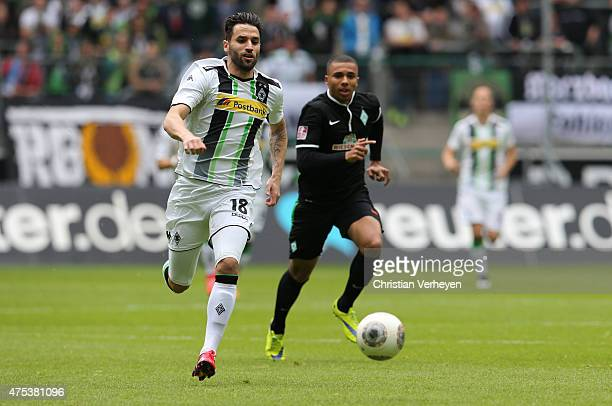 Giuseppe Pisano of Borussia Moenchengladbach is chased by Leon Guwara of Werder Bremen during the 3 Liga Playoffs match between Borussia...