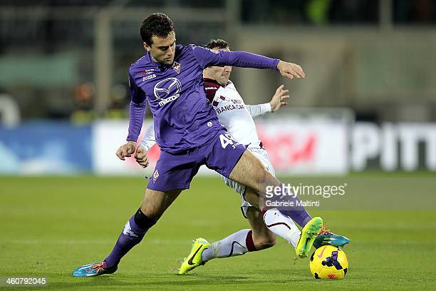Giuseppe Rossi of ACF Fiorentina fights for the ball with Andrea Luci of AS Livorno Calcio during the Serie A match between ACF Fiorentina and AS...