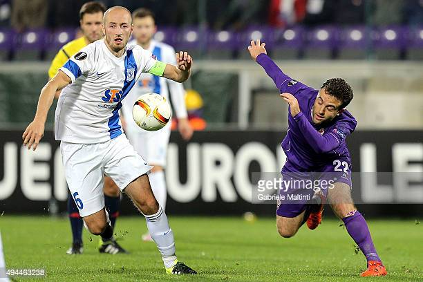 Giuseppe Rossi of ACF Fiorentina in action against Lukasc Traika of KKS Lech Poznan during the UEFA Europa League group I match between ACF...