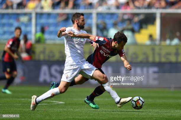 Giuseppe Rossi of Genoa CFC is tackled by Milan Badelj of ACF Fiorentina during the serie A match between Genoa CFC and ACF Fiorentina at Stadio...