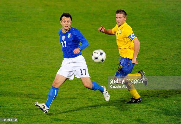 Giuseppe Rossi of Italy and Anders Svensson of Sweden in action during the international friendly match between Italy and Sweden at Dino Manuzzi...