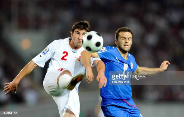 Giuseppe Rossi of Italy and Ucha Lobbjanidze during the FIFA 2010 World Cup Qualifier match between Georgia and Italy at Boris Paichadze National...