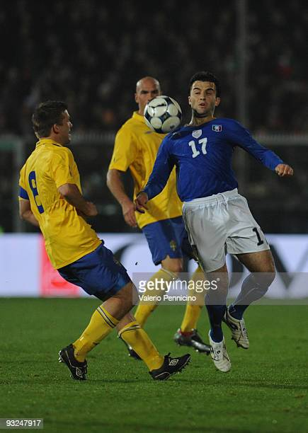 Giuseppe Rossi of Italy is challenged by Anders Svensson of Sweden during the international friendly match between Italy and Sweden at Dino Manuzzi...