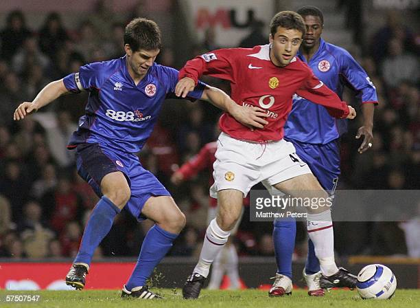 Giuseppe Rossi of Manchester United clashes with Chris Riggott of Middlesbrough during the Barclays Premiership match between Manchester United and...