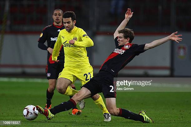 Giuseppe Rossi of Villarreal is challenged by Daniel Schwaab of Leverkusen during the UEFA Europa League round of 16 first leg match between Bayer...