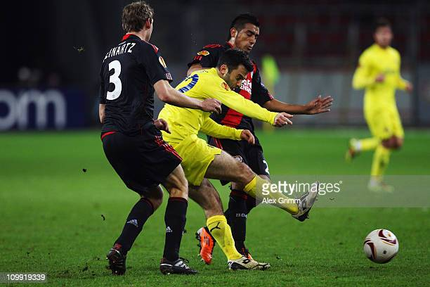 Giuseppe Rossi of Villarreal is challenged by Stefan Reinartz and Arturo Vidal of Leverkusen during the UEFA Europa League round of 16 first leg...