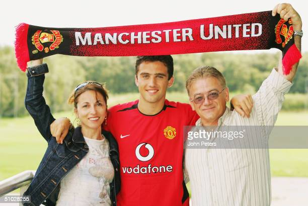 Giuseppe Rossi poses with family members mother Cleotilde and father Fernando after signing for Manchester United on July 6 2004 at Carrington...
