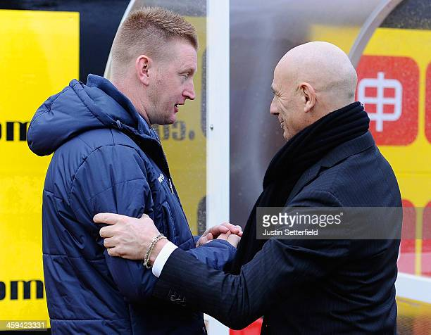 Giuseppe Sannino manager of Watford shakes hands with Steve Lomas Manager of Millwall FC ahead of the the Sky Bet Championship match between Watford...
