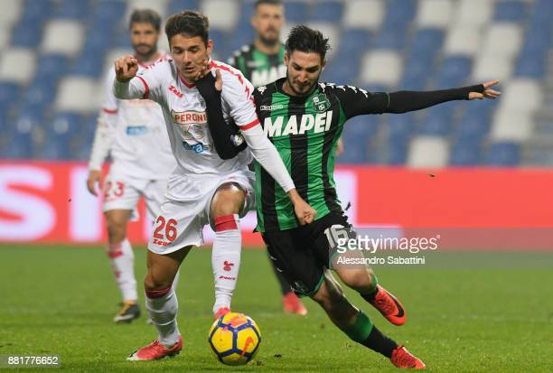 Giuseppe Scalera of Bari competes for the ball whit Matteo Politano of US Sassuolo during the TIM Cup match between US Sassuolo and Bari on November...