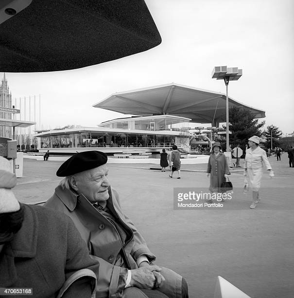 Giuseppe Ungaretti is visiting the World's Fair in New York on board of a greyhound vehicle seated next to his wife barely visible the great Italian...