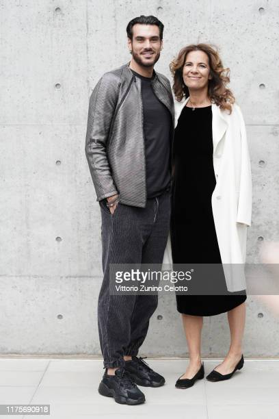 Giuseppe Vicino and Roberta Armani attend the Emporio Armani fashion show during the Milan Fashion Week Spring/Summer 2020 on September 19, 2019 in...