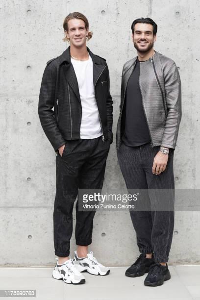 Giuseppe Vicino, Giacomo Gentili, Manuel Bortuzzo and Flavia Pennetta attend the Emporio Armani fashion show during the Milan Fashion Week...