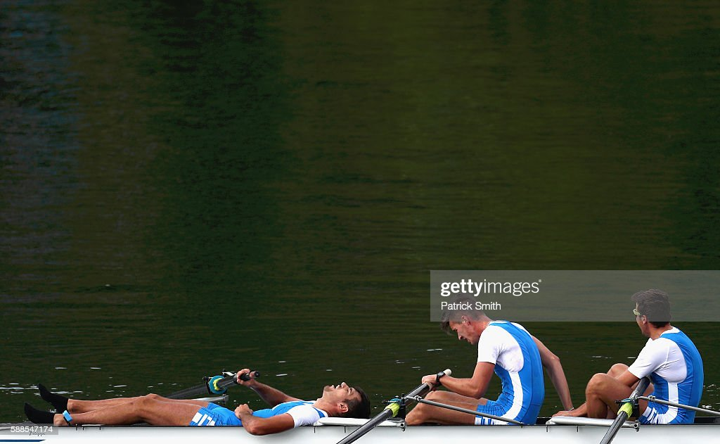 Giuseppe Vicino, Matteo Lodo, and Matteo Castaldo react after competing in the Men's Four Semifinal on Day 6 of the 2016 Rio Olympics at Lagoa Stadium on August 11, 2016 in Rio de Janeiro, Brazil.