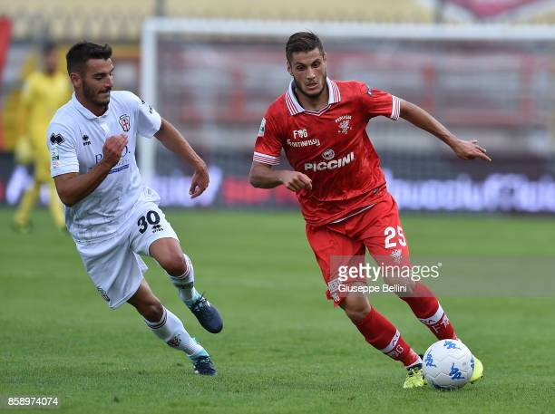 Giuseppe Vives of Pro Vercelli and Filippo Falco of AC Perugia in action during the Serie B match between AC Perugia and Pro Vercelli at Stadio...