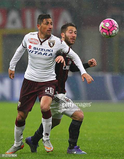 Giuseppe Vives of Torino FC competes for the ball with Ignazio Andrea Bertolacci of AC Milan during the Serie A match between AC Milan and Torino FC...