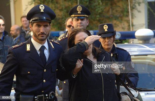 Giuseppina Nappa wife of Francesco ' Sandokan' Schiavone the boss of the Camorra' s clan Casalesi covers her face while being escorted by Italian...