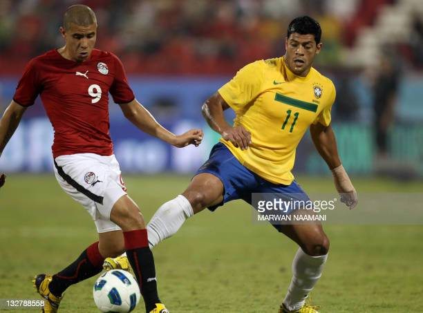 Givanildo Vieira of Brazil competes with Mohmed Zedan of Egypt during the two teams' international friendly match in Doha Qatar on November 14 2011...