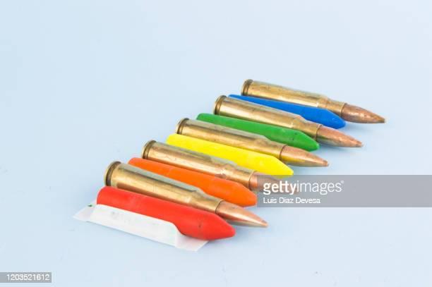 give away colored pencils that do not kill - metralhadora imagens e fotografias de stock