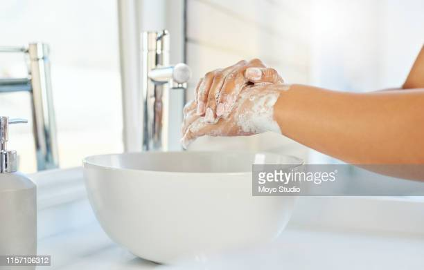 give germs a zero chance - washing hands stock pictures, royalty-free photos & images