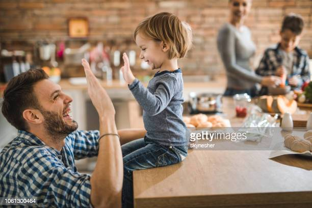 give me high-five son! - congratulating stock pictures, royalty-free photos & images