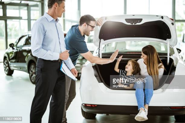 give me high-five son, we are buying this car! - new stock pictures, royalty-free photos & images
