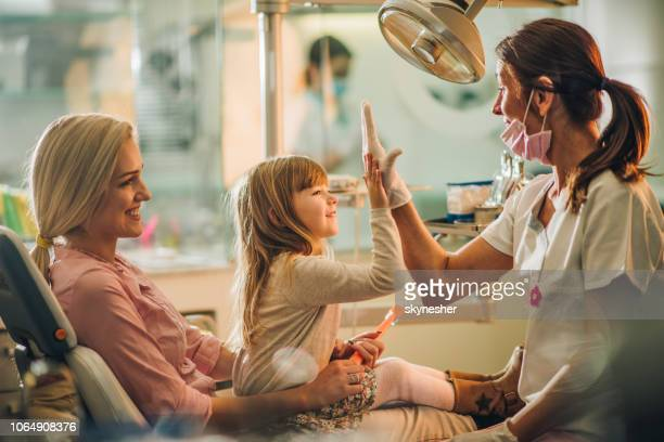 give me high-five, you were great at dental exam! - dentist stock pictures, royalty-free photos & images