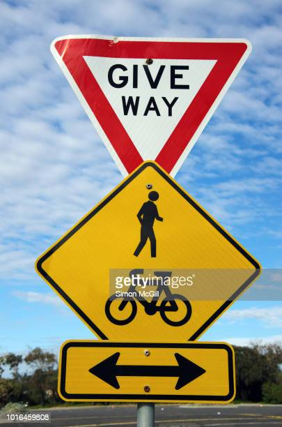 give way and at a pedestrian and bicycle lane crossing - give way stock pictures, royalty-free photos & images