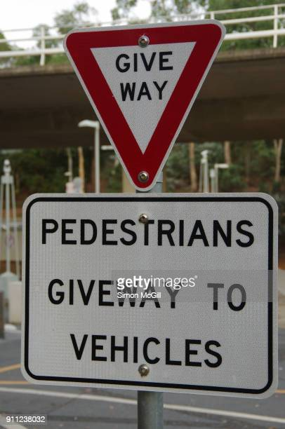 give way and pedestrians give way to vehicles signs - give way stock pictures, royalty-free photos & images