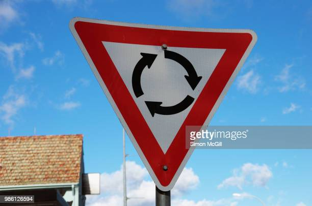 give way roundabout traffic circle sign - give way stock pictures, royalty-free photos & images