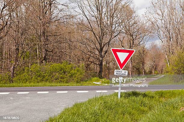 a give way sign at a junction in france. - give way stock pictures, royalty-free photos & images
