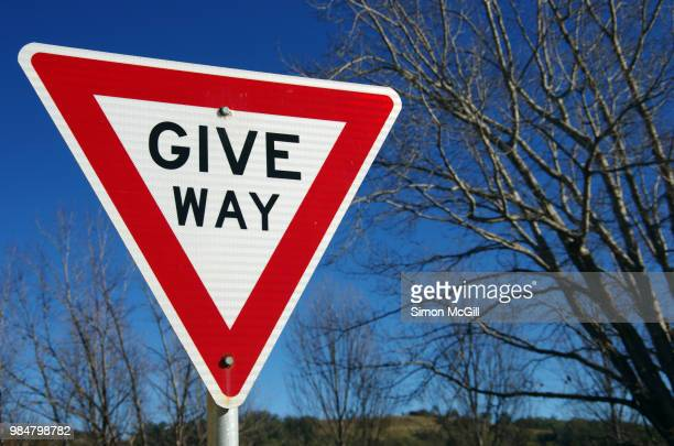 give way sign - give way stock pictures, royalty-free photos & images