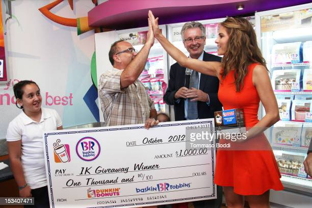 Giveaway winner, CEO Dunkin' Brands and President of Dunkin' Donuts Nigel Travis and Maria Menounos attend the Dunkin' Donuts K-Cup packs introduced...