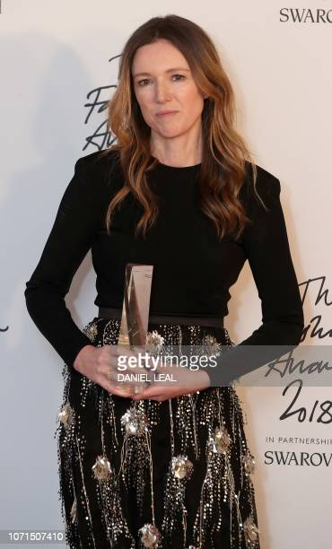 Givency's British fashion designer Clare Waight Keller poses with her award for British designer of the year Womenswear during the British Fashion...