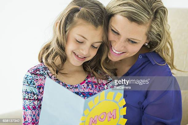 giving a card on mother's day - mothers day card stock pictures, royalty-free photos & images