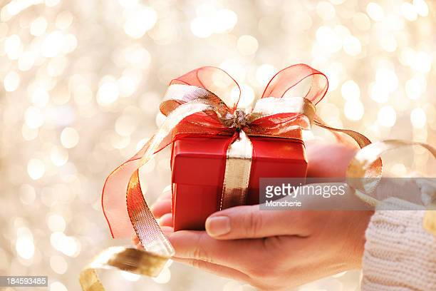 giving a christmas present - christmas gifts stock photos and pictures