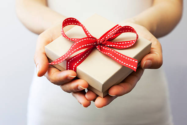 Free gift giving images pictures and royalty free stock photos giving a gift negle Choice Image