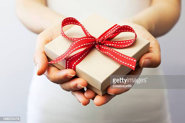 giving a gift - giving stock photos and pictures