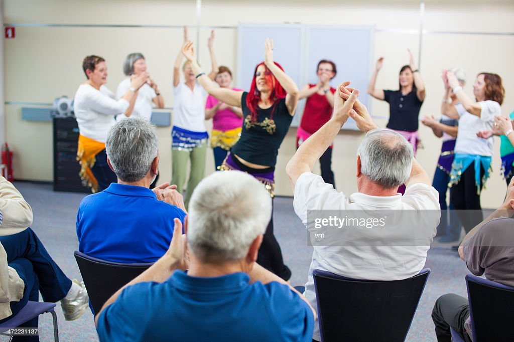 Giving Accompaniment To Professional Belly Dancer : Stock Photo