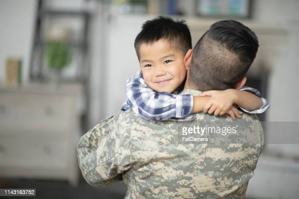 giving dad a big hug - filipino family reunion stock pictures, royalty-free photos & images