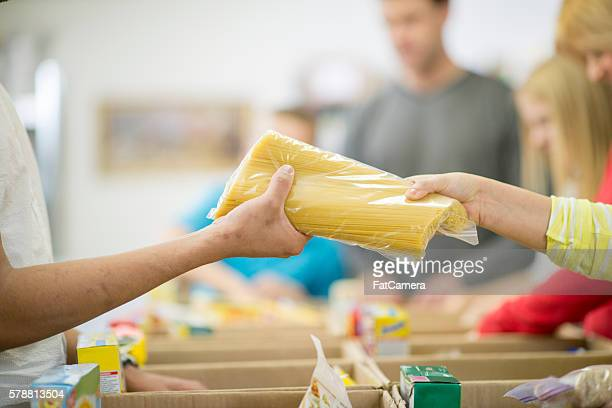 giving food for the homeless - food staple stock pictures, royalty-free photos & images