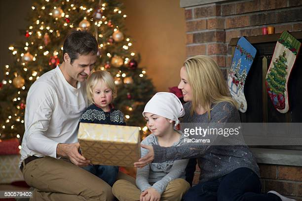giving gifts at christmas - patients brothers stock pictures, royalty-free photos & images