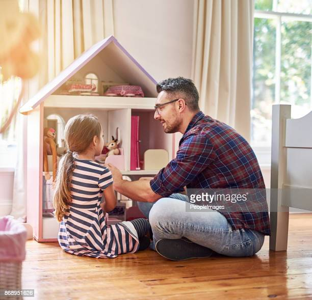 giving her daddy the grand tour - dollhouse stock pictures, royalty-free photos & images