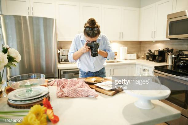 giving her followers a taste of her specialty - influencer photos stock photos and pictures