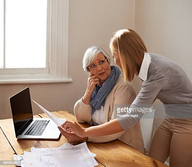 giving her grandmother some much needed assistance - grandma invoice stock pictures, royalty-free photos & images